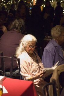 Older woman reading the program