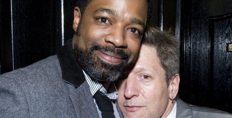 Photo of two men hugging