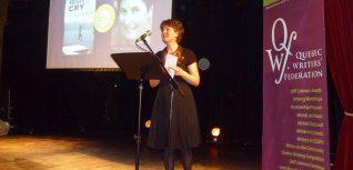 Woman reading at a podium