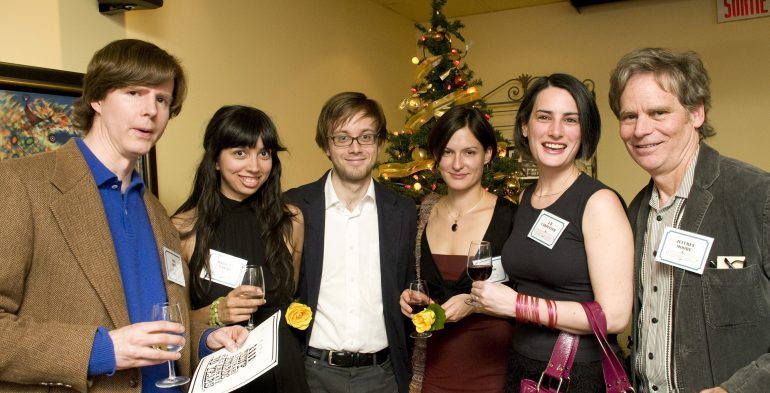 A group of folks holding wine glasses