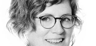 black and white photo of a woman wearing glasses
